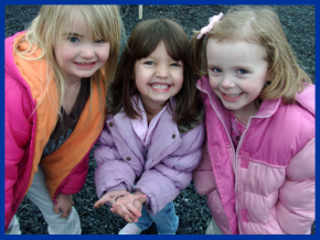 3 girls smiling with worm